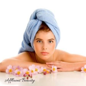 Steaming of hair with hot towel for hair spa treatment